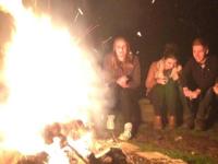 Group enjoying a warm fire